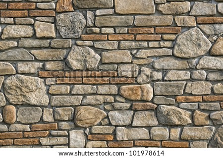 Old stone and brick wall background