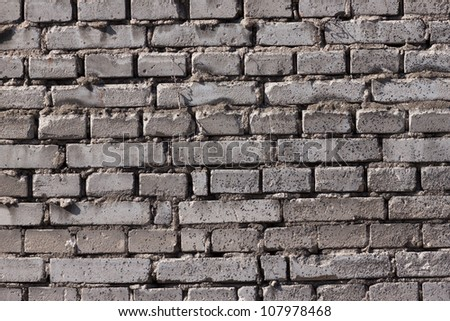Old stone brick wall of a house