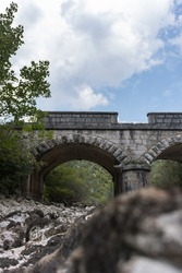 Old stone bridge and dry riverbed in hot summer. Knin in Croatia.