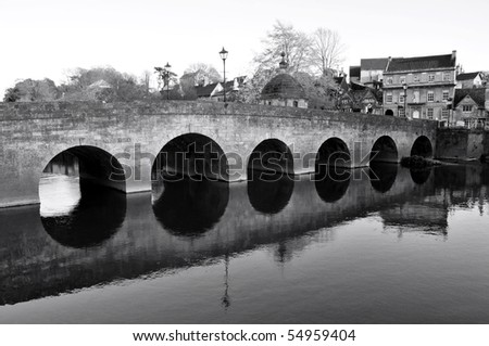 old stone bridge in black and...