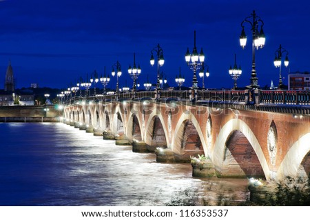 Old stone bridge in Bordeaux, France