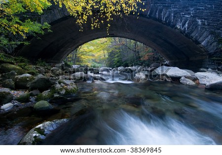 Old stone bridge over river in the Great Smoky Mountains