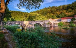 Old stone bridge over the river in a mountain village. River bridge view. Old stone bridge. River bridge in village