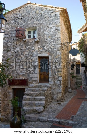 Old stone building in the medieval city of Exe, France, which is a fortress, built on cliff-side hill - stock photo