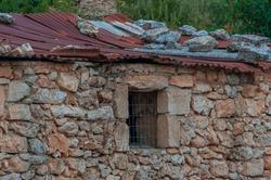 Old stone building with tin roof, Zakynthos island, Greece