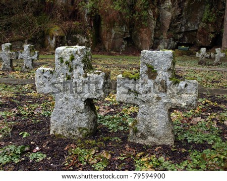 old stone celtic crosses on a graveyard in ireland for german soldiers - stock photo