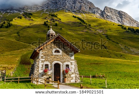 Photo of  Old stone chapel in mountains. Mountain chapel view. Chapel in mountains. Stone chapel in mountains