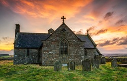 Old stone church at sunrise. Stone church cemetary. Ancient old stone church view. Church cemetery