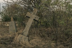 Old Stone Cross Grave Markers on Abandoned Cemetery