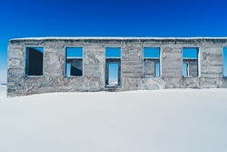 old stone fort ruins in snow