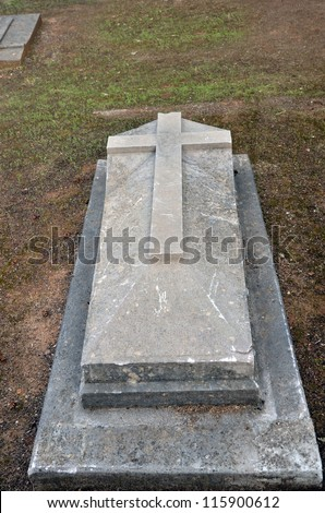 old stone grave with a cross