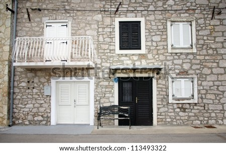 Old stone house with shutters in front view, Croatia