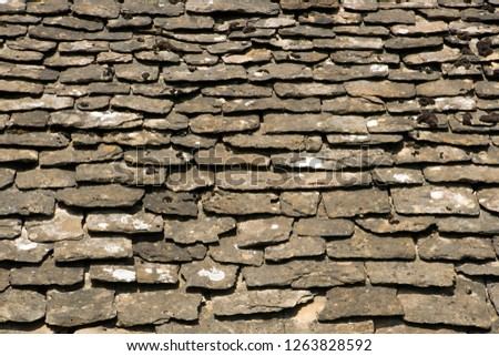 Old stone roof tiles covered with lichens and mosses background texture #1263828592