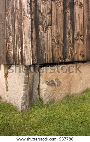 Old stone slab foundation of a barn in a Shaker village in Canterbury, NH, - stock photo