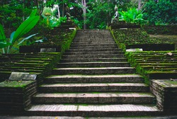 Old stone stair case in the ancient temple with moss