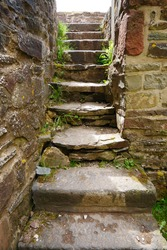 old stone staircase made of large stone slabs in a medieval European castle ruin