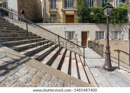 Old Stone staircase. Montmartre district in Paris, France. Famous historical center of Art, where artists live. Tourism travel vacation holidays in Europe.