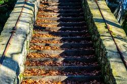 Old stone staircase on Terezinka. Sunny autumn day. Tanvald, Czech Republic