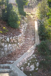 Old stone staircase. Steps to the house. A long ruined staircase.