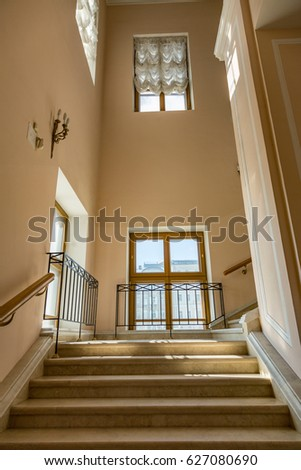 Old Stone Staircase With A Handrail In A Building Without An Elevator