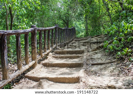 Old Stone staircase with wood railing in jungle, Kanchanaburi,Thailand