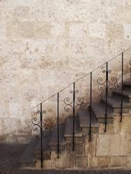 Old stone stairs with metal railings, Peru.