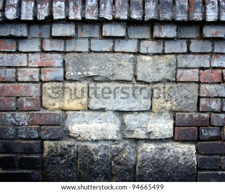 Old stone wall filled with bricks, texture