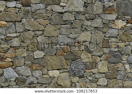 Old Stone Wall in the Countryside - stock photo