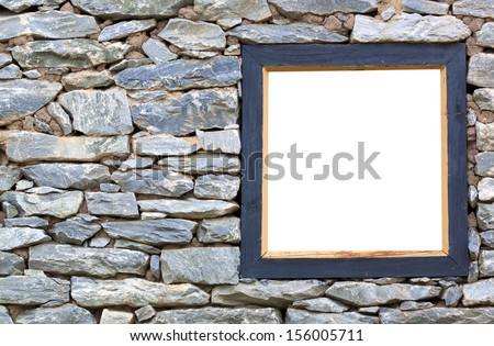 Old stone wall with a wood frame wall.