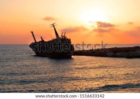 Old stranded ship at sunset. Paphos. Cyprus