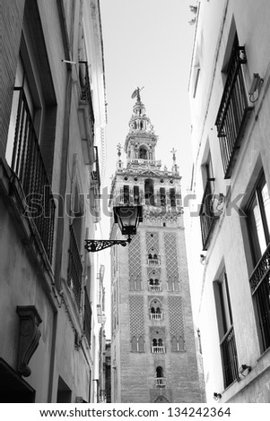 Old street and Giralda bell tower, Seville