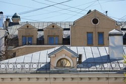 Old street facades and roofs of houses. Arch window. Moscow residential buildings. Old Moscow architecture, beautiful facade, typical russian houses on sunny day