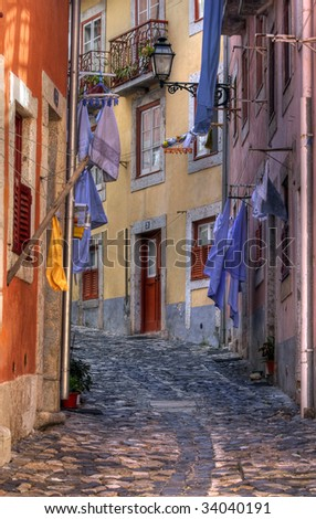 Old street in Lisbon - stock photo