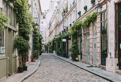 Old street in Paris, France. Cozy cityscape of Paris. Architecture and landmarks of Paris.