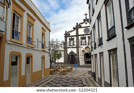 Old street in Ponta Delgada and the view of Igreja Matriz de Sao Sebastiao