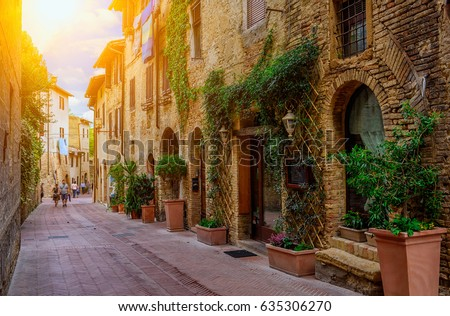 Old street in San Gimignano, Tuscany, Italy. San Gimignano is typical Tuscan medieval town in Italy.
