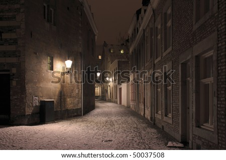 Old street in the center of Maastricht on a wintry night