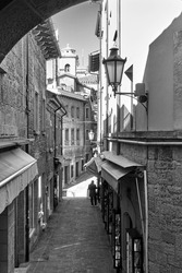 Old street in the City of San Marino, The Republic of San Marino. Black and white cityscape