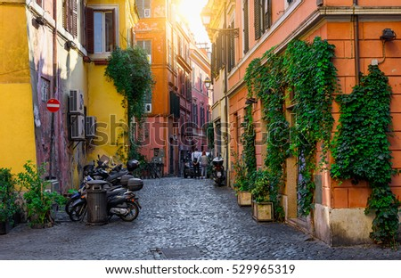 Old street in Trastevere, Rome, Italy. Trastevere is rione of Rome, on the west bank of the Tiber in Rome, Lazio, Italy.  Architecture and landmark of Rome #529965319