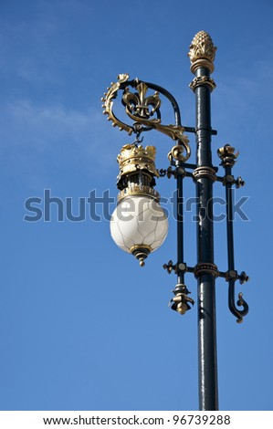 Old street lamp next to the Royal Palace of Madrid, Spain