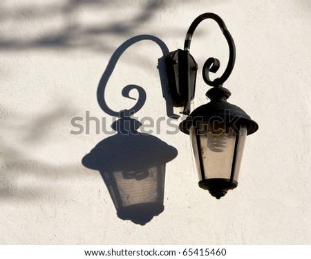 Old street lamp with modern electric bulb