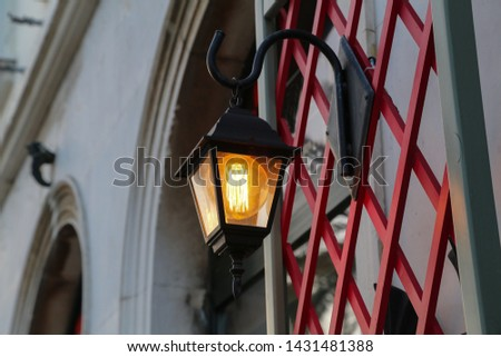 Old street lamps illuminate the way for passersby #1431481388