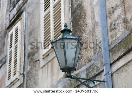 Old street lamps illuminate the way for passersby #1439681906