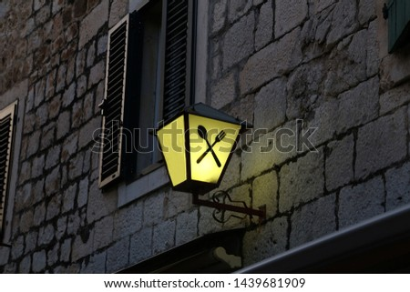 Old street lamps illuminate the way for passersby #1439681909