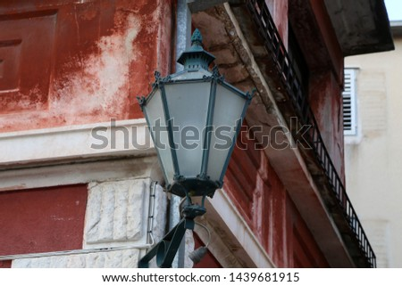 Old street lamps illuminate the way for passersby #1439681915
