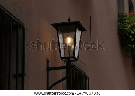 Old street lamps illuminate the way for passersby #1499007338
