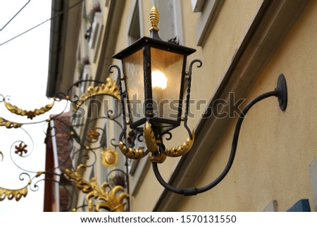 Old street lamps illuminate the way for passersby #1570131550