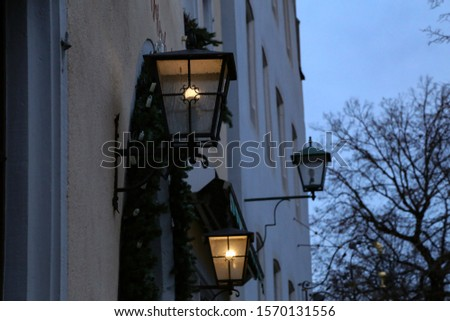 Old street lamps illuminate the way for passersby #1570131556