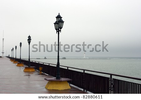 Old street lights on the dock against the sea