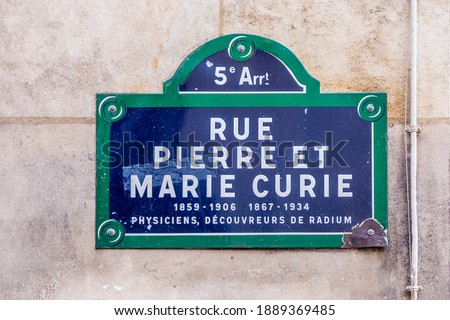 old street sign  Rue Pierre et Marie Curie - english: street Pierre and Marie Curie in the old historic part of Paris, France with text physicist, explorer of the element radium Photo stock ©